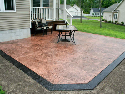 Backyard patio made from stamped and colored concrete in Connecticut.