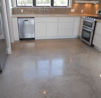 Interior decorative concrete floor done in a kitchen.