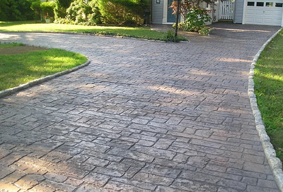 Old styled concrete driveway stamped and colored.