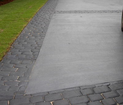 Gray, broom finished concrete driveway with stamped border.