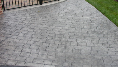 Cobblestone style driveway made from stamped concrete.