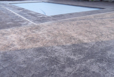 Gray colored in ground pool deck.