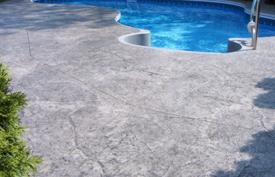 Light gray textured decorative pool deck.