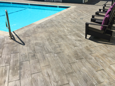 Wood plank style pool deck in Stamford.