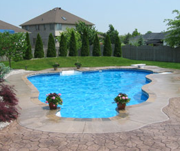 Stamped concrete pool deck around a built in pool.